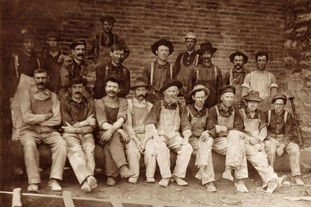 Pictured: Eric Holmlund with his masonry crew in Minneapolis, Minnesota, 1927. Tim's Grandfather, upper row, 5th from right.