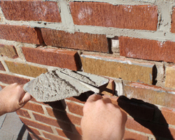 Stone retaining wall repair and tuckpointing are needed ... |Tuck Point Mortar Retaining Wall